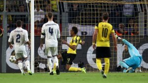 DORTMUND, GERMANY - SEPTEMBER 27: Pierre-Emerick Aubameyang of Borussia Dortmund (17) scores their first goal during the UEFA Champions League Group F match between Borussia Dortmund and Real Madrid CF at Signal Iduna Park on September 27, 2016 in Dortmund, North Rhine-Westphalia. (Photo by Alex Grimm/Bongarts/Getty Images)