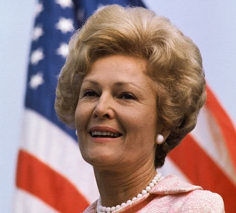 "16 Aug 1971, McLean, Virginia, USA --- Original caption: McLean, Virginia: Mrs. Richard Nixon is pictured with the American flag during ceremonies at McLean, Virginia, where she started a five state visit to see the tangible results of the president's ""Legacy of Parks"" program. --- Image by © Bettmann/CORBIS"