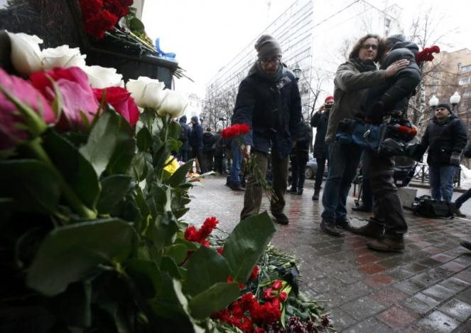 A cameraman from Russian Zvezda channel, whose colleagues were on board of Russian military Tu-154 plane crashed into the Black Sea, is comforted by a man outside the headquarters of the Alexandrov Ensemble, also known as the Red Army Choir, in Moscow, Russia December 25, 2016. REUTERS/Sergei Karpukhin